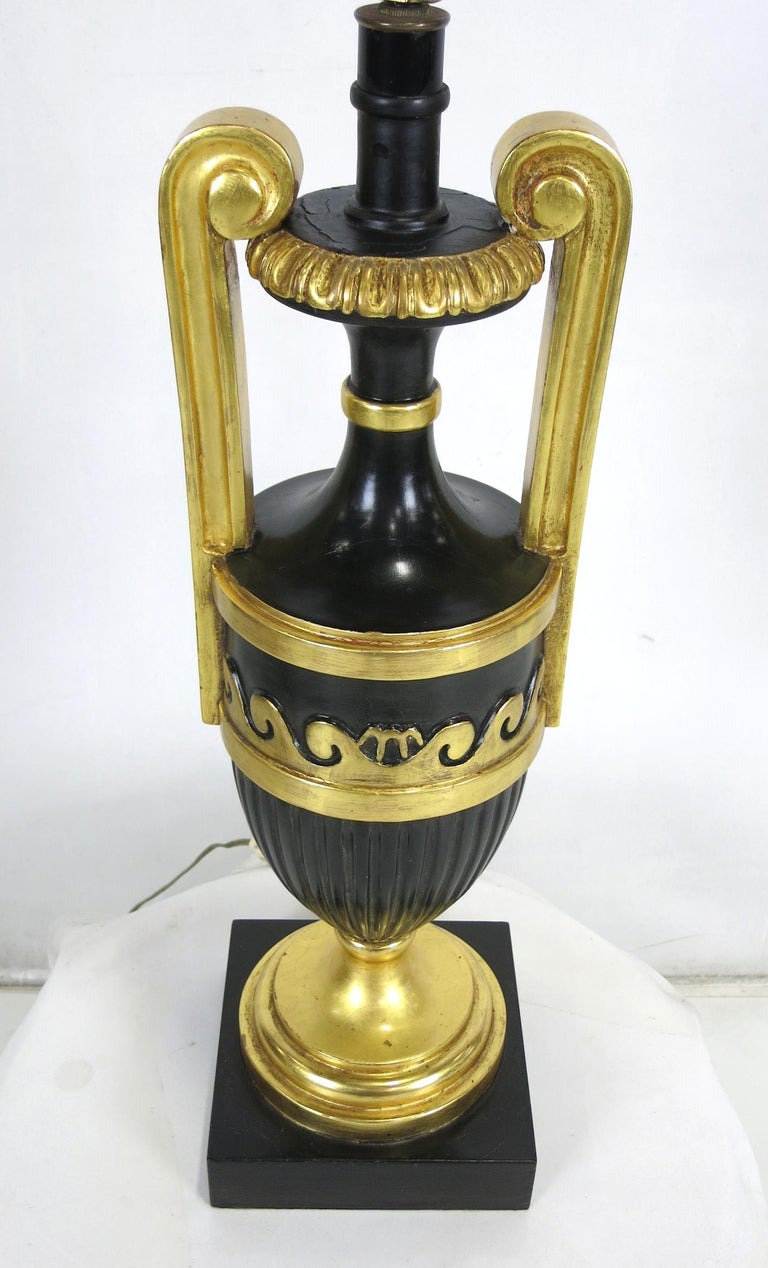 Exquisite pair of ebonized and giltwood table lamps by Marbro. The pair are beautifully carved and finished as expected from Marbro, the maker of the finest and most luxurious lamps ever.  Shades are for display only and are not included with the