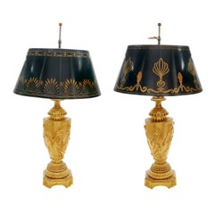 Pair of Neoclassical Gilt Bronze Urn Form Lamps with Tole Metal Shades