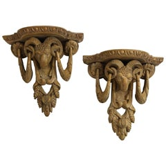 Pair of Neoclassical Ram's Head Limed Wall Brackets