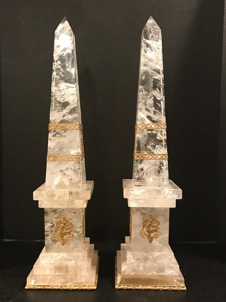 Pair of neoclassical rock crystal ormolu-mounted obelisks, each one of the finest specimen polished rock crystal, with delicate ormolu mounts.