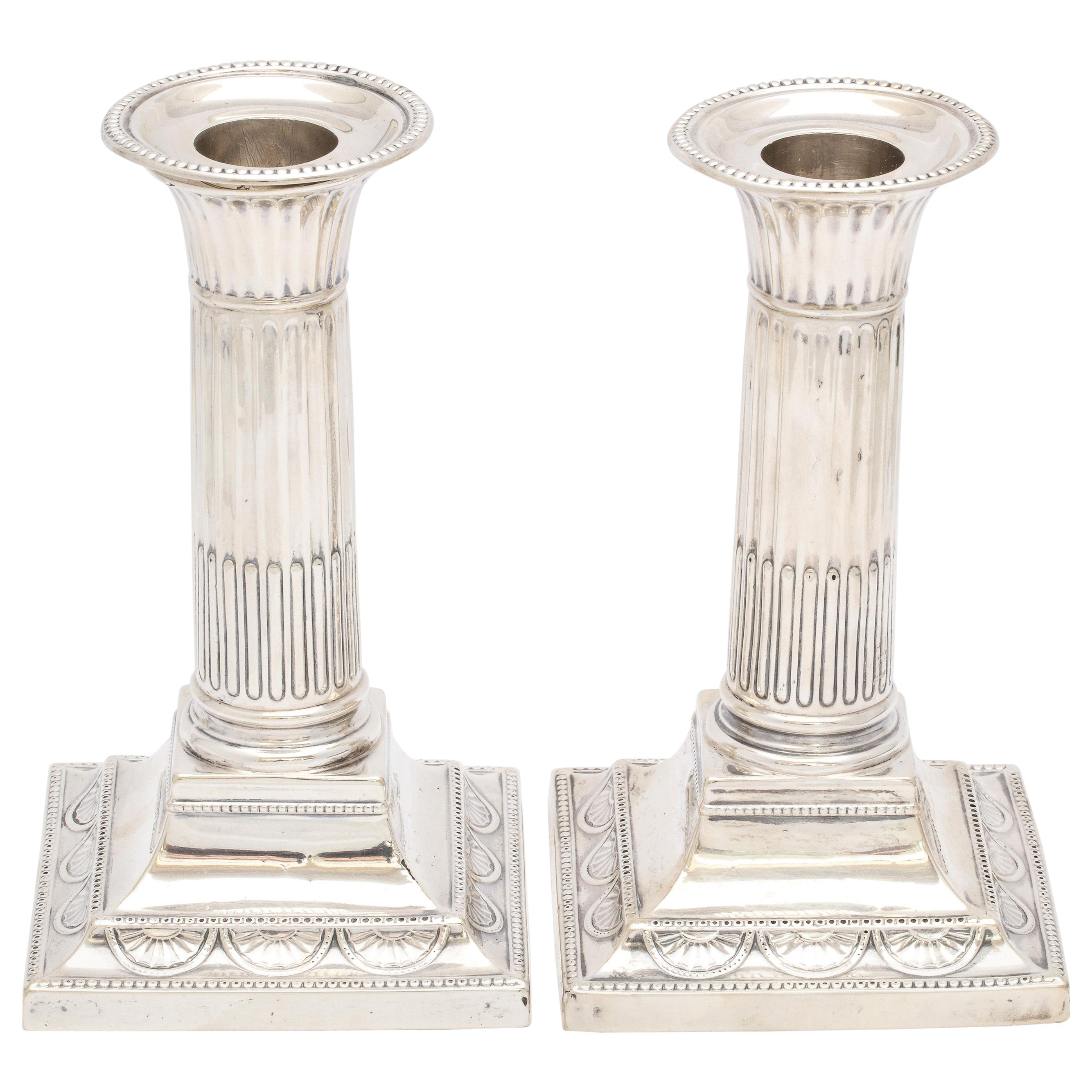 Pair of Neoclassical Sterling Silver Column-Form Candlesticks, Hutton and Sons
