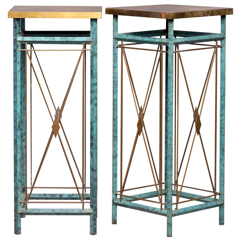 Pair of tall metal statue or plant stands feature verde green legs with contrasting brass x-form cross pieces with diamond shaped centers and brass table tops, circa 1960s. Found in Italy. Unknown maker. Sold and priced as a pair.