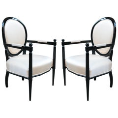 Pair of Neoclassically Inspired Ebonized Armchairs