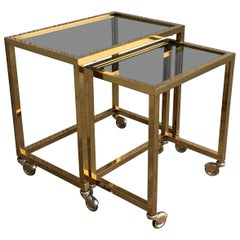 Pair of Nesting Tables Italian Design 1970 in Brass with Smoked Glass and Wheels