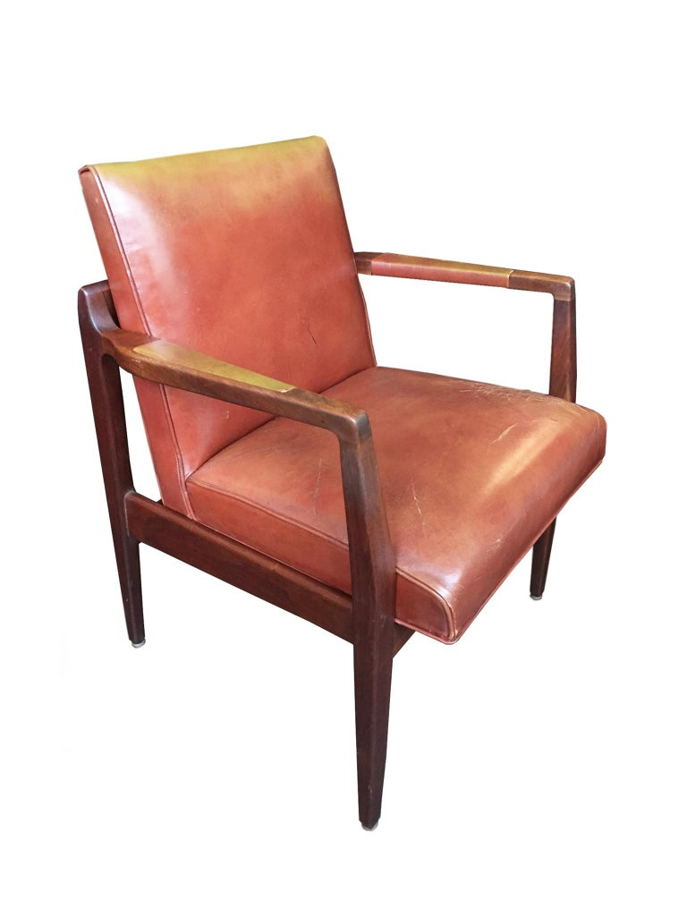 These two armchairs were designed and manufactured circa 1950s-1960s. They are crafted in the manner of the Danish American designer, Jens Risom, who infused American Modernism with elements of Scandinavian design. The chairs are comprised of a