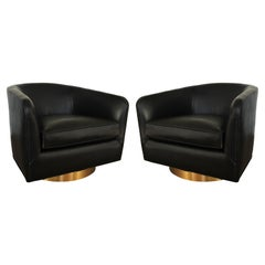 Pair of Newly Upholstered Black Milo Baughman Swivel Chairs with Brass Plinths