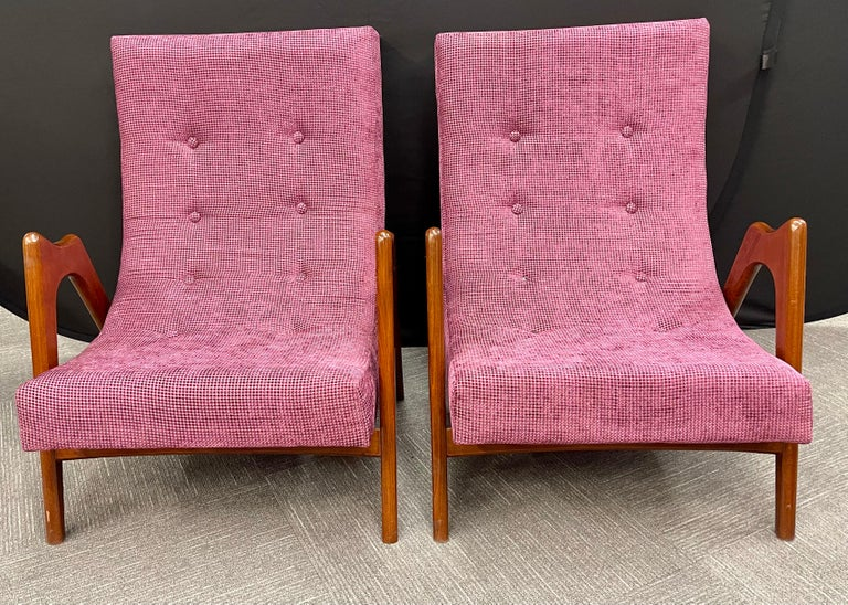 Pair of newly upholstered Mid-Century Modern armchairs. Recently acquired from a shopping trip overseas are one of four pair of Mid-Century Modern arm lounge chairs each in a different brand new upholstery (as seen in photos) and totally