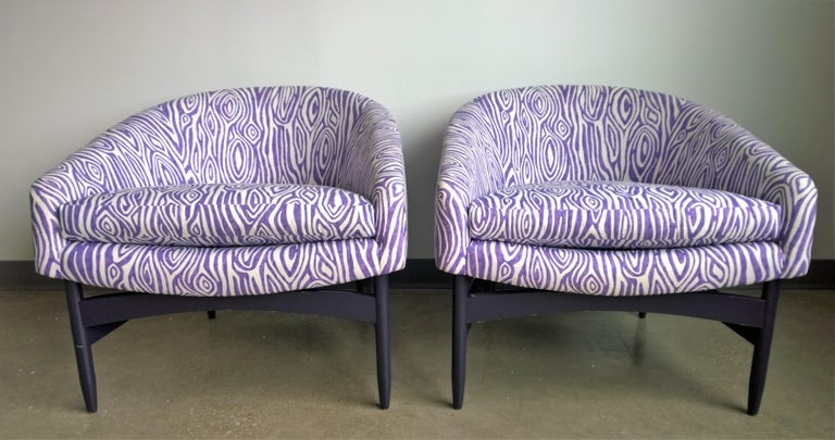 Offered is a pair of Mid-Century Modern Lawrence Peabody newly upholstered in purple and white animal print barrel back lounge chairs with newly lacquered wood frames. This pair features new faux bois pattern upholstery in electric orchid and white