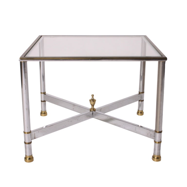 Pair of nickel and brass tables, circa 1950.