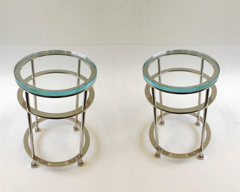"""An exceptional pair of polish nickel and clear Lucite occasional tables design by French designer Jean Michel Wilmotte for Mirak in the 1980s. The tables have new 1"""" thick Lucite tops. The tables are solid steel that's polished nickel"""