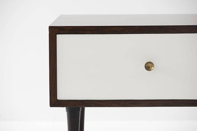 Geraldo de Barros (1923-1998)  Pair of nightstand tables Manufactured by Unilabor Brazil, 1956 Jacaranda, Formica, and brass handles.  Measurements: 53 cm x 39 cm x 42 H cm 20.8 in x 15.35 in x 16.5 H in.  Literature Unilabor, by Mauro