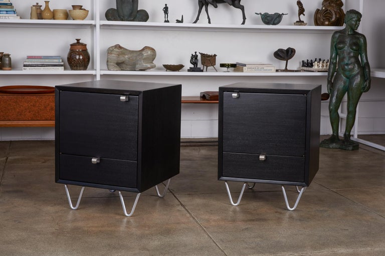 Pair of rare by George Nelson for Herman Miller Model 4617 nightstands, circa early 1950s. These Art Deco inspired pieces were part of Herman Miller's Basic Cabinet Series. They feature short aluminum hairpin legs and curved aluminum pulls on an