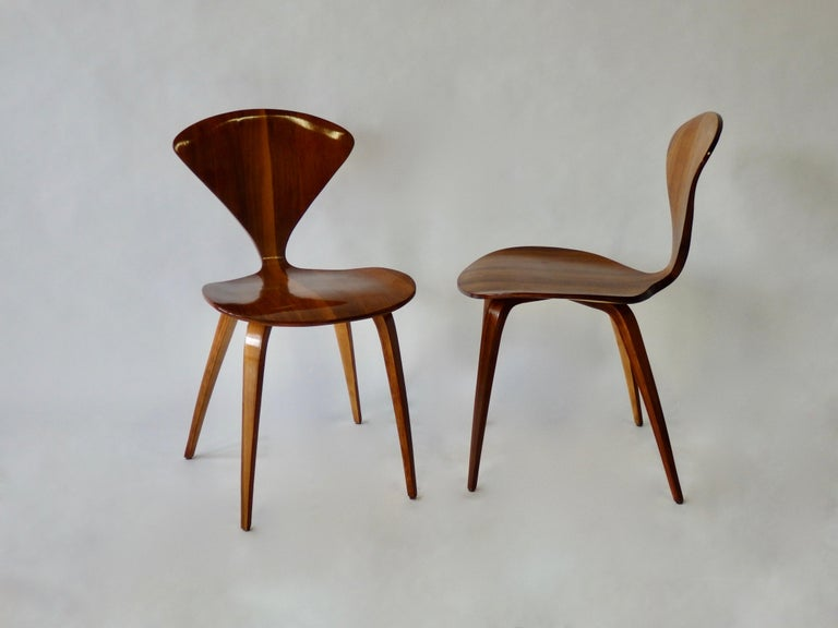 Nicely refinished pair of Norman Cherner side chairs.