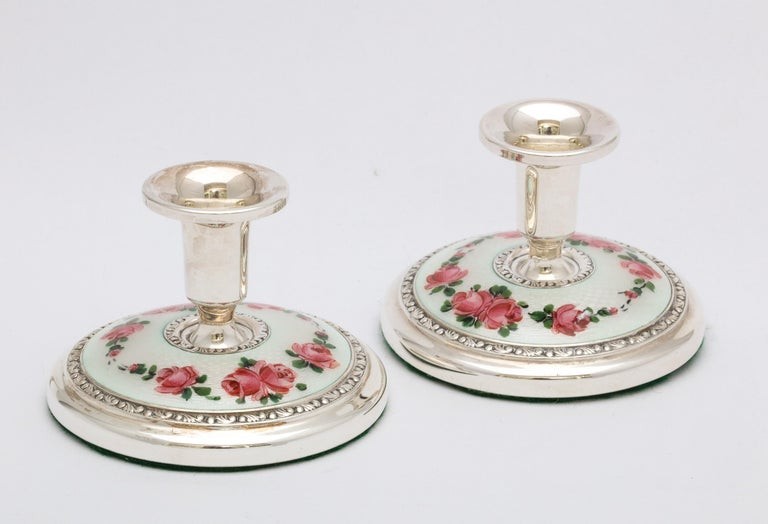 Pair of Art Deco sterling silver and white guilloche enamel (decorated with pink enameled roses and green leaves) candlesticks, Oslo, Norway, Norsk Solwarreindustri - makers, Ca. 1930's. Each candlestick measures 2 1/4 inches high x over 2 3/4