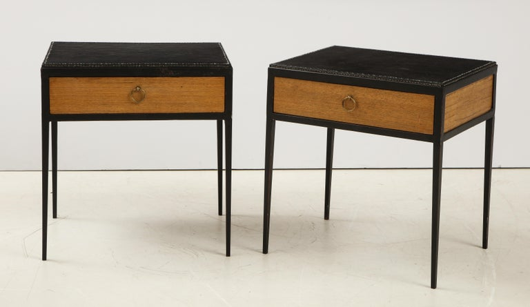 Pair of oak side tables inset with a stitched leather top in the manner of Jean Michel Frank.