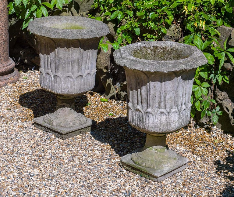 Neoclassical Pair of Octagonal Reconstituted Stone Urns For Sale