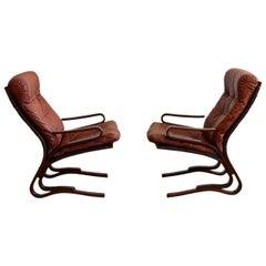 Pair of Oddvin Rykken Mid-Century Modern Leather Lounge Chairs