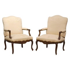 Pair of Off White Covered French Provincial 18th Century Carved Walnut Bergeres