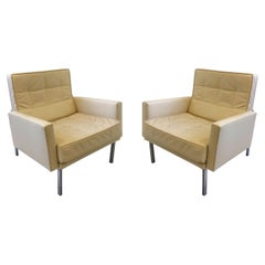 Pair of off White Leather and Stainless Steel Lounge Chairs by Florence Knoll