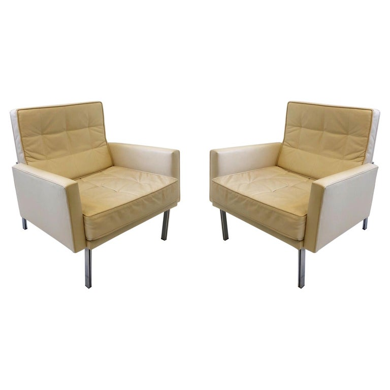 Pair of off White Leather and Stainless Steel Lounge Chairs by Florence Knoll For Sale