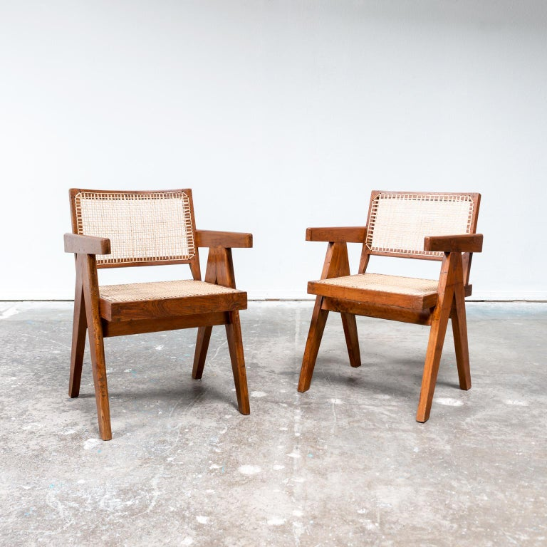 A pair of iconic office armchairs designed by Pierre Jeanneret for Chandigarh, India. Teak and cane, 1950s.