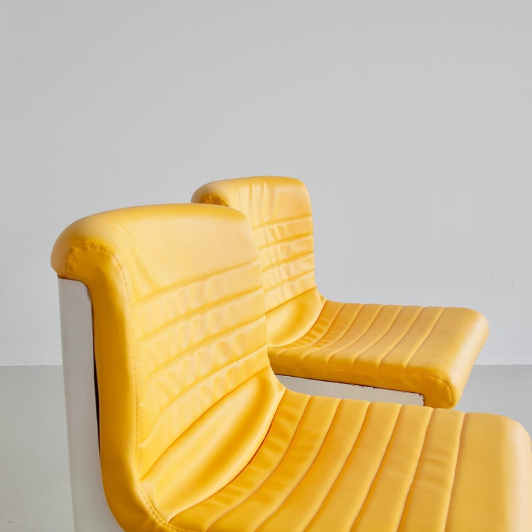 Pair of office chairs designed by Ettore Sottsass and Hans Von Klier. Italy, Design Centre (Poltronova), 1969.  An original set of the 'PROGRESS' swivel chairs, height-adjustable. Original yellow leatherette upholstery, frame in cast aluminium with