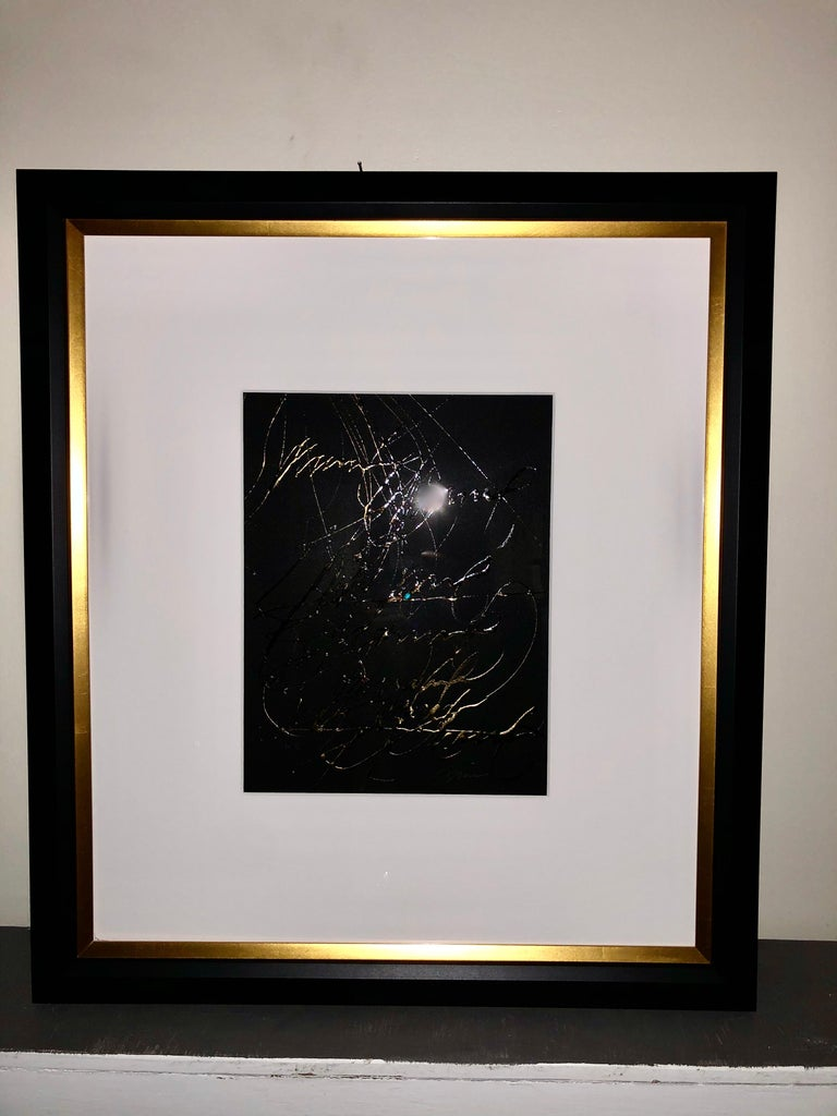 Pair of gilt oil on paper calligraphy paintings signed Francine Turk. Newly matted and framed in gilt and plain black wood frame.