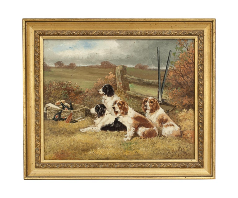 Pair of signed oil paintings of gun dogs. A nice small pair of oil on board paintings of hunting gun dogs, Spaniels. Both signed by British artist Sylvester Martin, dated 1902. The pair of field Springer spaniel oil paintings have undeniable charm,