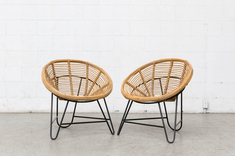 Set of two midcentury bamboo onion skin patterned Hoop chairs with black enameled metal hair pin frames.
