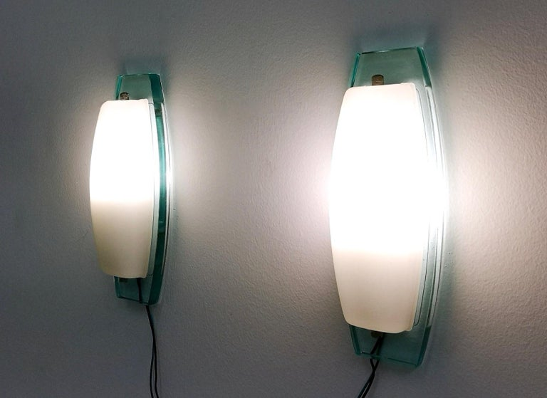 Made in white opaline glass and a very thick aquamarine glass structure.  They are vintage, therefore they might show slight traces of use, but they can be considered as in excellent original condition and ready to give ambiance to any