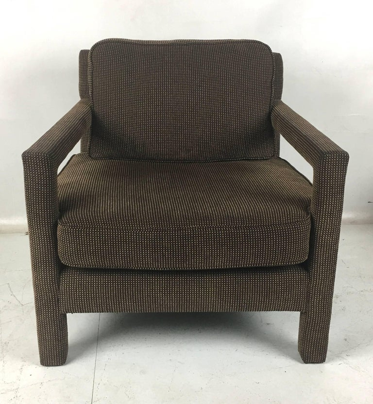 Handsome pair of fully upholstered, open-arm club chairs by Milo Baughman. The pair are beautifully scaled, super comfortable, and as stylish is it gets. Most every important designer had a version of this chair in their catalog, from John Dickinson
