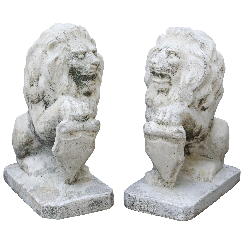 Pair of Opposing Cast Stone Lion Garden Ornaments