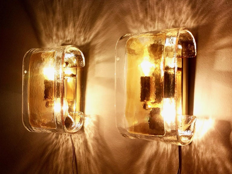 They are made in Murano glass and brass and marked La Murrina. These wall lights are in excellent original condition, even if they're vintage, and they are ready to give ambiance to any room.   Measures: Width 16 cm Depth 12 cm Height 25 cm.