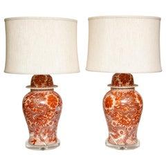 Pair of Orange and White Ceramic Lamps