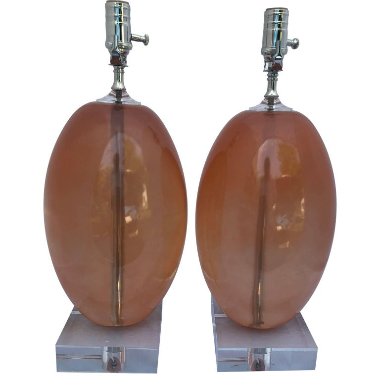 American Pair Of Orange Ellipse-Shaped Resin Table Lamps On Thick Lucite Base For Sale