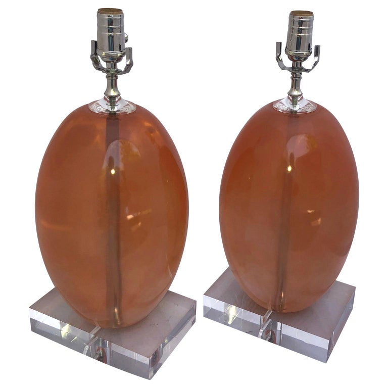 Pair Of Orange Ellipse-Shaped Resin Table Lamps On Thick Lucite Base For Sale