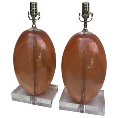 Pair of Orange Ellipse-Shaped Resin Table Lamps on Thick Lucite Base