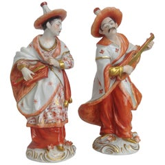Pair of Orange Gold Dresden Porcelain Figurines Chinese Musicians, 20th Century