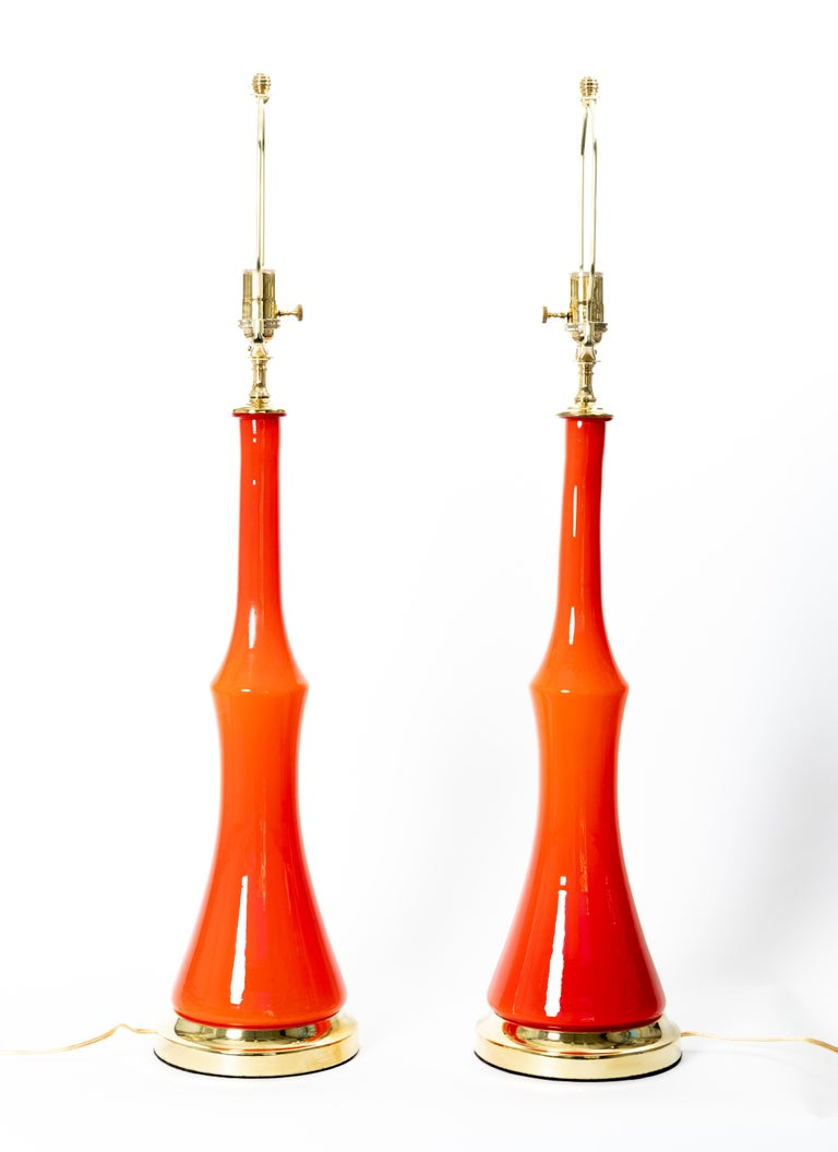 Pair of orange Murano glass table lamps with brass detail.