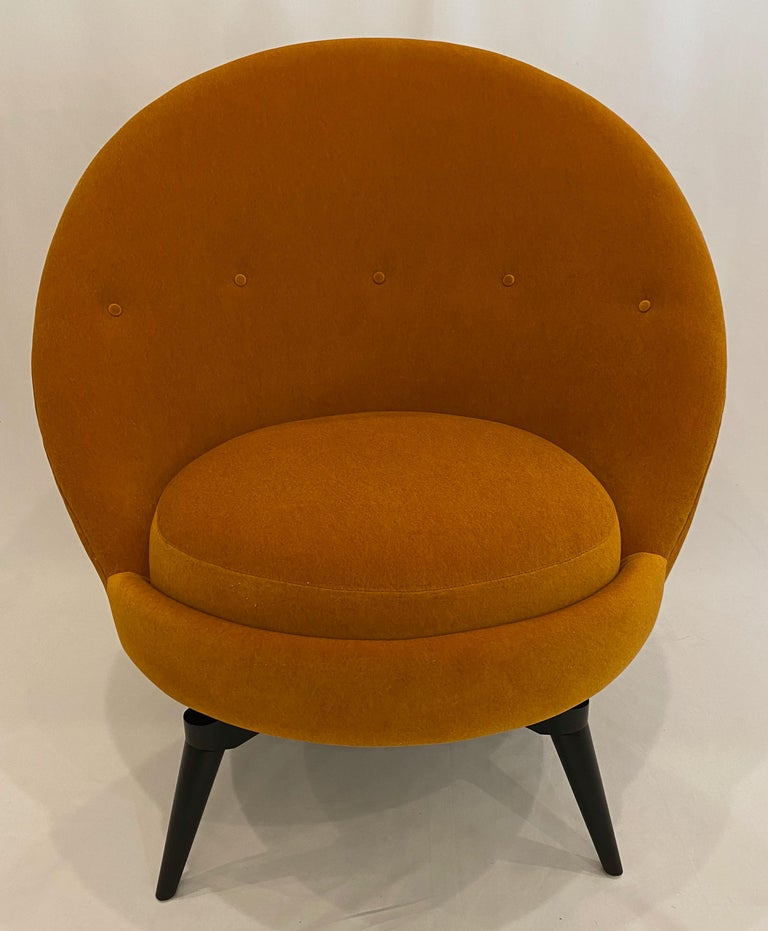 Swivel egg chair in the French midcentury style. This sophisticated chair is upholstered in luxurious heavy weight, Muslin backed Orange/Ochre knit Mohair. This super stylish and versatile example is as comfortable as it looks and is painstakingly