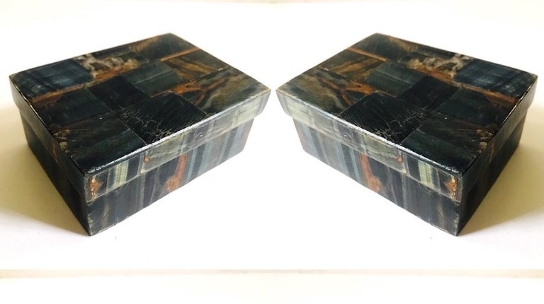 Gorgeous handcrafted lidded trinket boxes or decorative boxes in tessellated stone. Boxes feature inlays of multicolored blue tiger eye stone in hues of blue, rust, brown, and dark green. Interior box is made of palmwood. Signed R&Y Augousti on