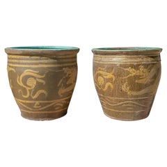 Pair of Oriental Style Ochre Colored Pots with Dragon Decoration