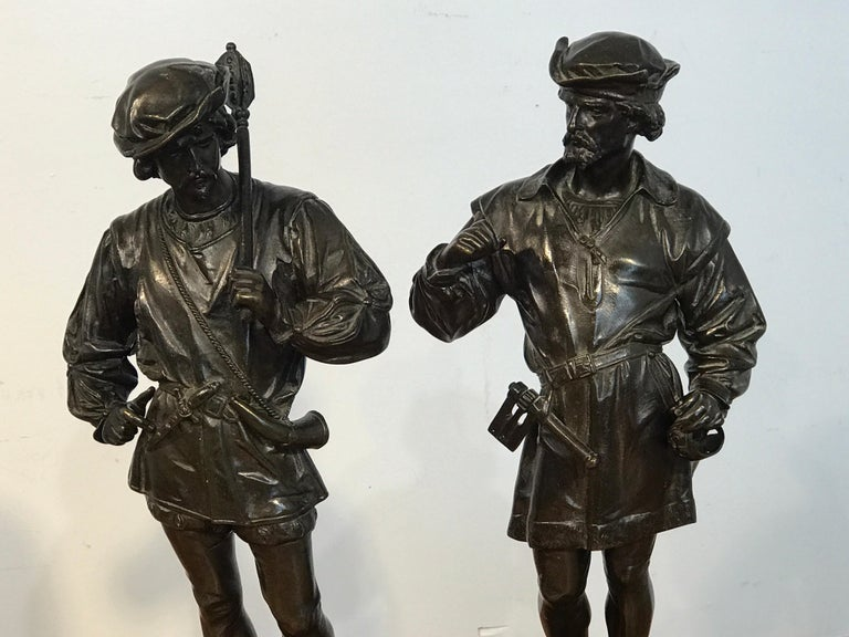 Pair of orientalist bronzes of standing Turks, signed Guillot, Anatole-Jean-Thomas Guillot French (1865-1911) Each one intricately dressed holding weapons, raised on Belgian black marble plinths.