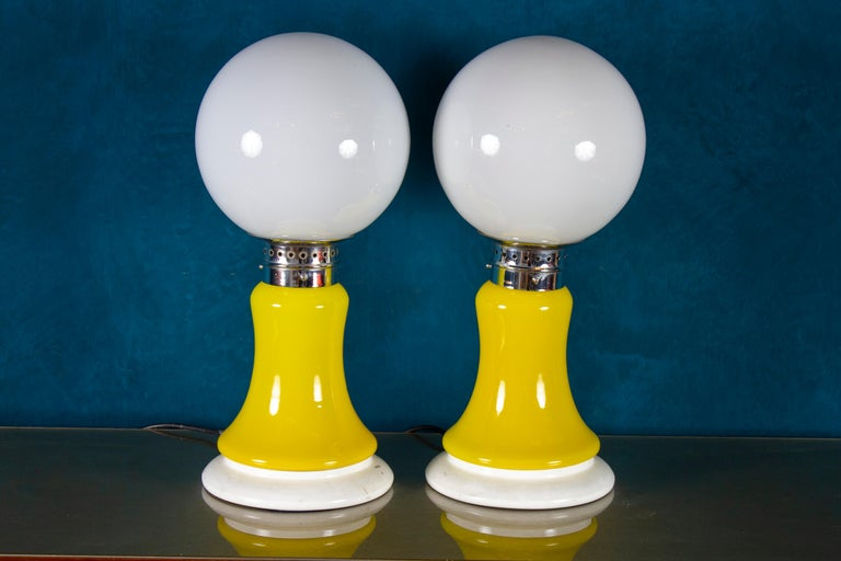 Amazing Mazzega pair of table lamps. Made of yellow glass and chrome-plated metal.  Perfect vintage condition.