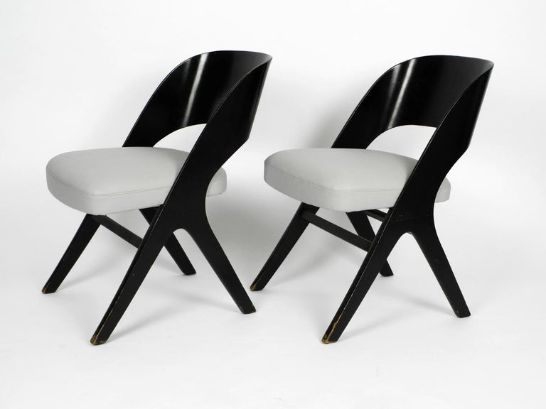 Pair of very rare and beautiful original Mid-Century Modern black and grey chairs by Carl Sasse for Casala reupholstered. X legs made of black lacquered wood. Curved backrest made of plywood. Very high quality and great minimalistic 1950s design