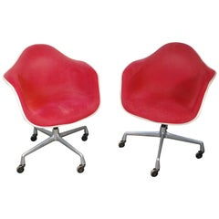Pair of Original Tagged Molded Swiveling Eames Chairs by Herman Miller