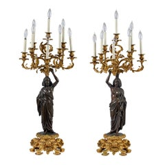Pair of Ormolu and Patinated Bronze Figural Eight-Light Candelabras