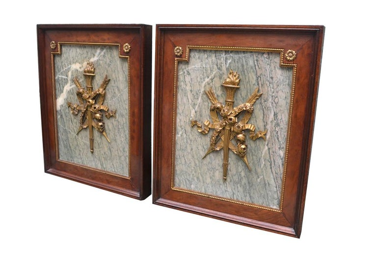 A pair of armorial Ormolu mounts and Turquin grey marble wall plaques presented in mahogany frames with gilded bronze mounts and banding.