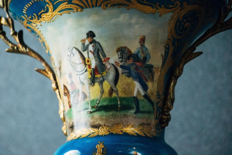 An admirable pair of ormolu-mounted Sevres-style 'Napoleonic' porcelain vases with covers.