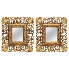 Pair of Ornately Pierce-Carved and Giltwood Rococo Mirrors, Early 19th Century